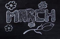 3月手写在黑板 免版税库存照片