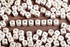 2月,信件把词切成小方块 免版税库存图片