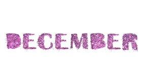 12月,在白色背景紫色闪烁隔绝的冬季的名字 免版税库存照片