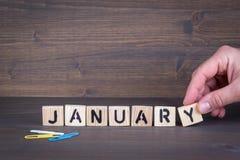 1月 在办公桌,情报和通信背景的木信件 免版税库存图片