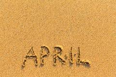 4月-在金沙子海滩的词题字 库存图片