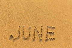 6月-在金沙子海滩的词题字 库存图片