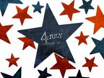 7月4日独立日词在红色和蓝星的手文字 库存照片