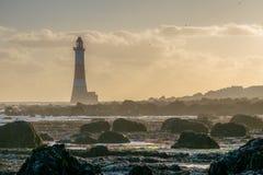 2015年9月12日,象海滨顶头灯塔处于低潮中 库存照片