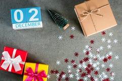 12月2日 图象2在圣诞节的天12月月,日历和与礼物的新年背景 免版税库存图片
