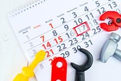 1月17日 天17在白色日历和玩具的月 天  免版税库存图片