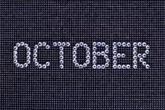 月10月在一黑canva被做假钻石水晶颜色 免版税库存照片