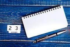 11月23th日 11月23th日日历的图象在蓝色背景的 免版税库存照片