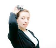 有一个冠的女商人在题头 免版税库存照片