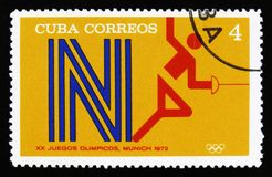 有一个击剑者的图片的古巴,从系列XX夏天奥运会,慕尼黑, 1972年,大约1973年 库存图片