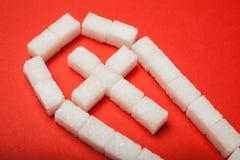 有一个十字架的糖棺材在红色背景 免版税库存图片