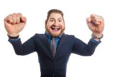 有一个大头的一个奇怪的办公室人在一个蓝色衣服身分被隔绝反对白色背景 免版税库存照片