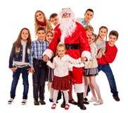 有一个小组的圣诞老人孩子 库存图片