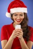 有一个巧妙的电话的愉快的妇女 图库摄影