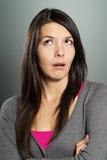 有一个怀疑表示的可爱的妇女 免版税图库摄影