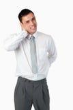有一个新的生意人的纵向背部疼痛 免版税图库摄影