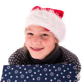 有一个新年箱子的青少年的女孩 库存照片