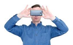 有一个智能手机的人在他的手上,隔绝在白色背景 免版税库存照片