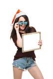 有一个标志的妇女在白色圣诞节帽子 库存图片