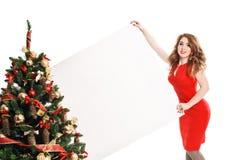 有一个标志的妇女在白色圣诞节帽子 库存照片