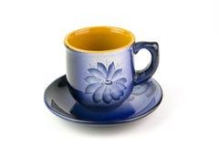 有一个样式的美丽的蓝色杯子在白色背景 图库摄影