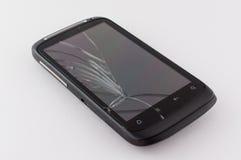 有一个残破的屏幕的手机 免版税库存照片