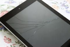 有一个残破的屏幕的片剂个人计算机 库存图片