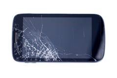 有一个残破的屏幕的黑手机在一被隔绝的backgroun 免版税库存图片