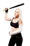 有一个残破的武器储备棒球棒的女孩 免版税库存图片