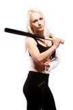 有一个残破的武器储备棒球棒的女孩 库存照片