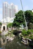 有一个池塘的城市公园在澳门 免版税库存照片