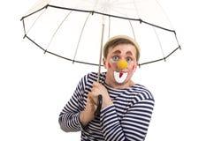 有一个滑稽的表示的一个愉快的小丑 免版税图库摄影