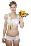 有一个牌照的美丽的女孩有蔬菜的 库存图片