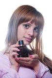 有一个瓶的白肤金发的女孩香水 库存图片