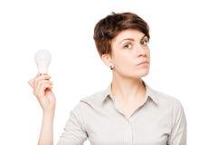 有一个电灯泡的女商人在手中在白色 库存图片