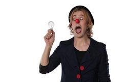 有一个电灯泡的小丑 图库摄影