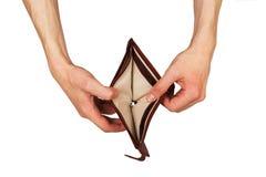有一个空的钱包的男性手 免版税库存照片