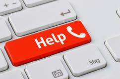 有一个红色按钮的键盘-帮助 免版税库存图片