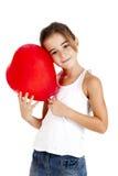 有一个红色气球的女孩 免版税库存照片