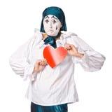 有一个红色重点的一个哀伤的女性笑剧小丑 免版税库存照片