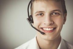 有一个耳机的用户支持操作员在白色背景 免版税库存照片