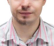 有一个胡子的人在面孔的一半。 库存照片