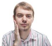 有一个胡子的人在面孔的一半。 免版税库存图片