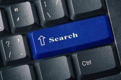 有一个蓝色按钮查寻题字标签的黑键盘 免版税图库摄影