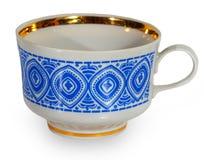 有一个蓝色样式的白色杯子 免版税库存照片