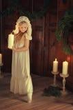 有一个蜡烛的女孩 图库摄影