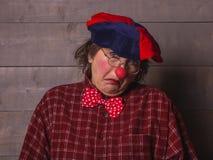 有一个表情的一个小丑不知道 免版税库存图片