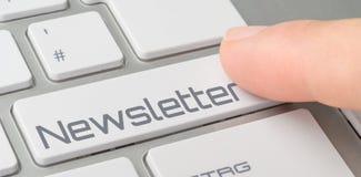 有一个被标记的按钮的键盘-时事通讯 免版税库存照片