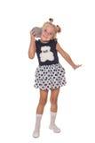 有一个装饰球的小女孩在手中 免版税库存图片