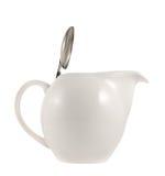有一个金属盖子盒盖的陶瓷茶壶 图库摄影